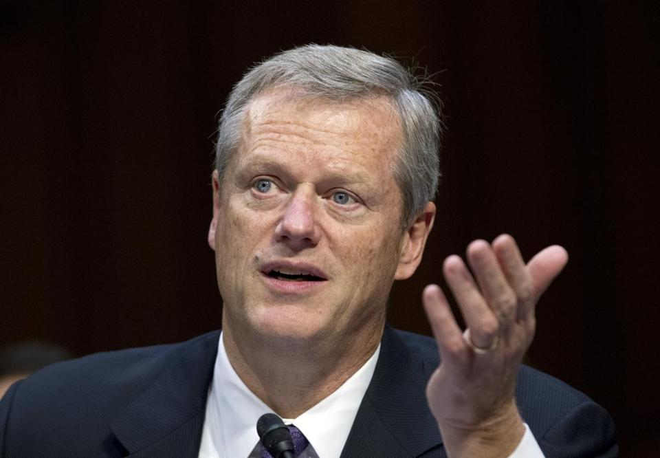 Governor Charlie Baker vetoed nine of the state budget's outside sections and $320.3 million across 169 line items. Above: Baker spoke Thursday on Capitol Hill.