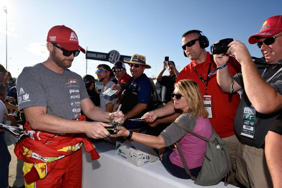 RICHMOND, VA - SEPTEMBER 08: Dale Earnhardt Jr., driver of the #88 AXALTA Chevrolet, signs autographs during qualifying for the Monster Energy NASCAR Cup Series Federated Auto Parts 400 at Richmond International Raceway on September 8, 2017 in Richmond, Virginia. (Photo by Jared C. Tilton/Getty Images)