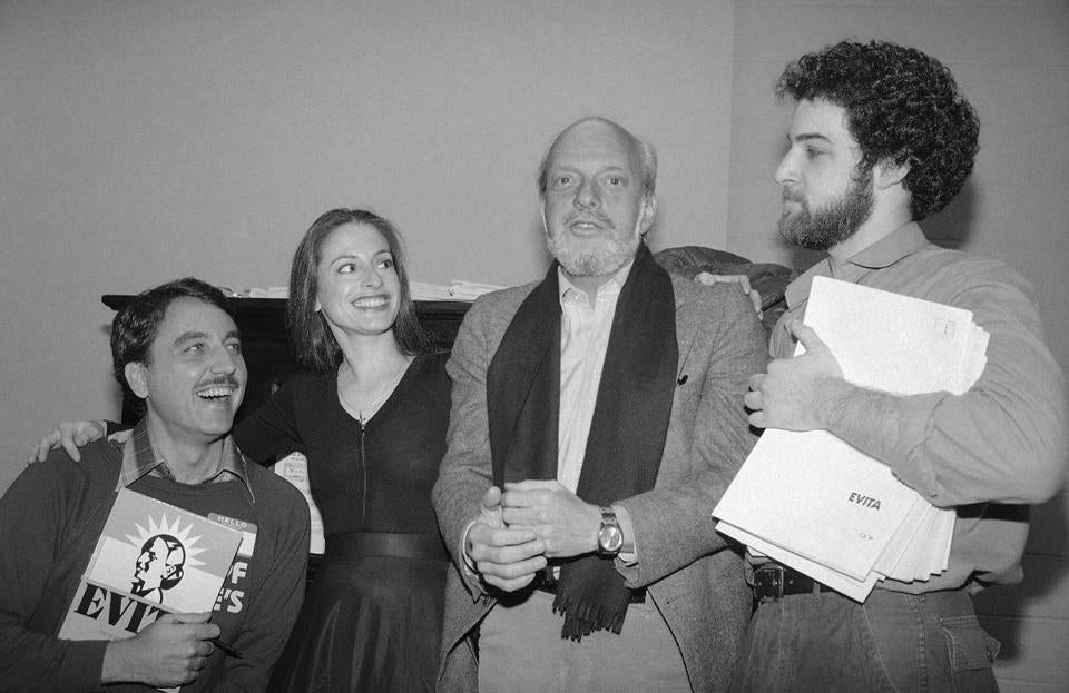 "Director Hal Prince, second from right, is shown at rehearsal of musical ""Evita"", April 10, 1979 in New York with performers in the production. From left are: Bob Gunton, who plays Juan Peron; Patti LuPone who plays Evita; Prince; and Mandy Patinkin who plays ""Che"" Guevara, right. (AP Photo/Marty Lederhandler)"