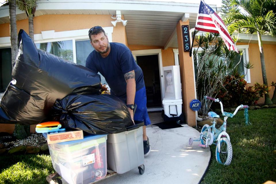 Brad Shows moved household items and supplies to his trailer as he complied with a mandatory evacuation as residents and visitors in Florida prepare ahead of Hurricane Irma on Saturday in St. Petersburg, Fla.