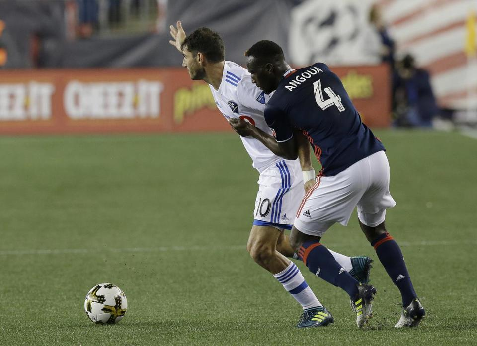 New England Revolution defender Angoua Brou Benjamin (4) holds back Montreal Impact midfielder Ignacio Piatti (10) as Piatti out positions Benjamin for a free ball during the first half of their MLS soccer game, Saturday, Sept. 9, 2017, in Foxborough, Mass. (AP Photo/Stephan Savoia)