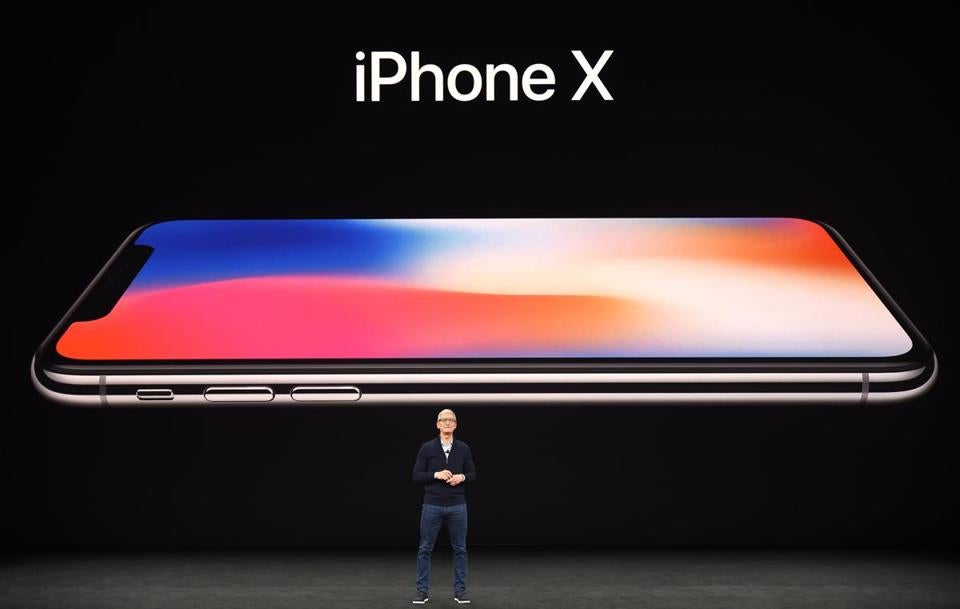 Apple CEO Tim Cook speaks about the new iPhone X during a media event in Cupertino, Calif., Tuesday. The handset lacks the signature home button that defined the design of previous iPhones.
