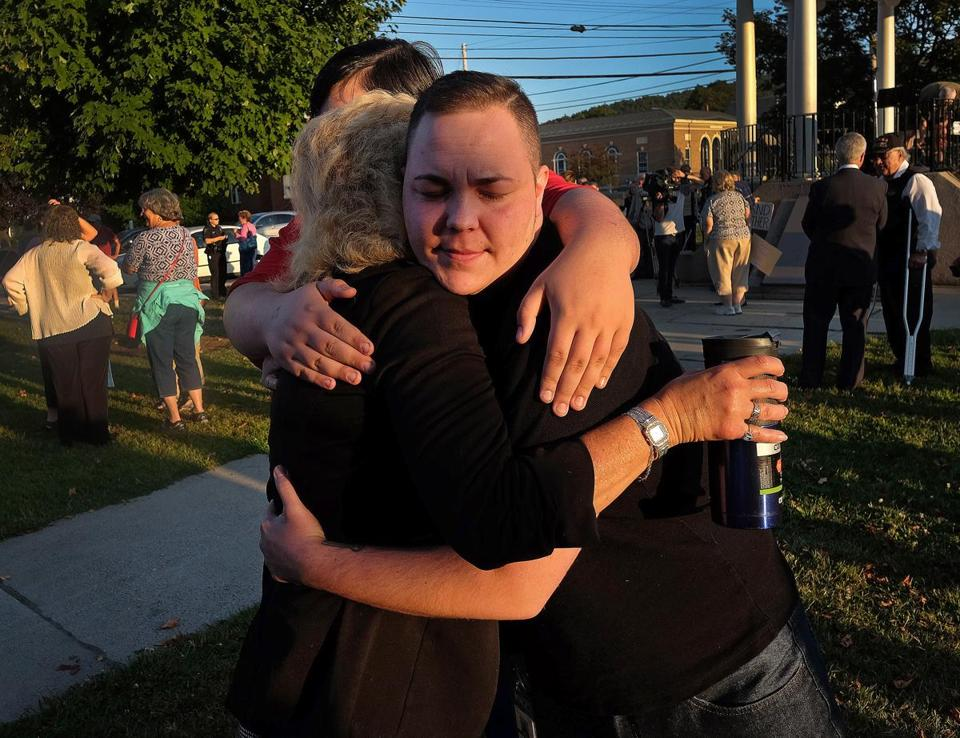 Lyrik Merlin (right), 30, hugged his mother Lorrie Slattery and his brother Nason Slattery, 16.