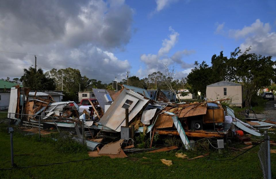 A trailer flattened by Hurricane Irma sits in a mobile home park in Immokalee, Fla. Only half of the state's mobile homes are insured. MUST CREDIT: Michael S. Williamson/The Washington Post.