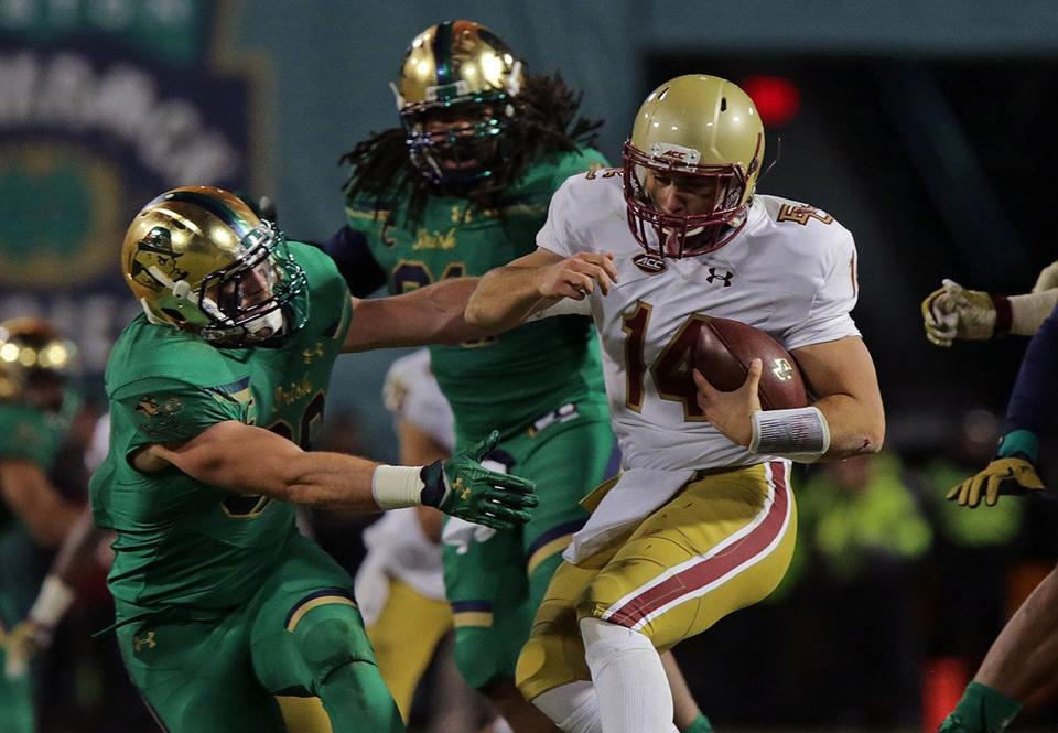 Boston, MA - 11/21/15 - (2nd quarter) Boston College Eagles quarterback John Fadule is sacked in the second quarter. The Notre Dame Fighting Irish take on the Boston College Eagles in the University's Shamrock Series at Fenway Park. Fenway Park last hosted a football game in1968. - (Barry Chin/Globe Staff), Section: Sports, Reporter: Michael Vega, Topic: 22Notre Dame-BC, LOID: 8.2.464867787.