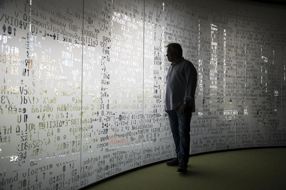 Eugene Kaspersky, the chief executive of Kaspersky Lab, looked trough a window decorated with programming code symbols at his company's headquarters in Moscow.