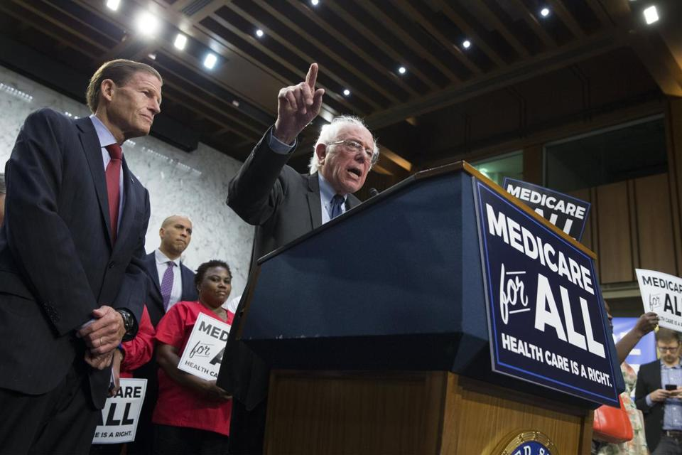 epa06202977 Independent Senator from Vermont Bernie Sanders (C) speaks beside Democratic Senator from Connecticut Richard Blumenthal (L) at an event announcing the 'Medicare for All Act of 2017', held with Democratic Senators and supporters of universal healthcare, on Capitol Hill in Washington, DC, USA, 13 September 2017. The legislation aims to provide Medicare for all Americans. EPA/MICHAEL REYNOLDS