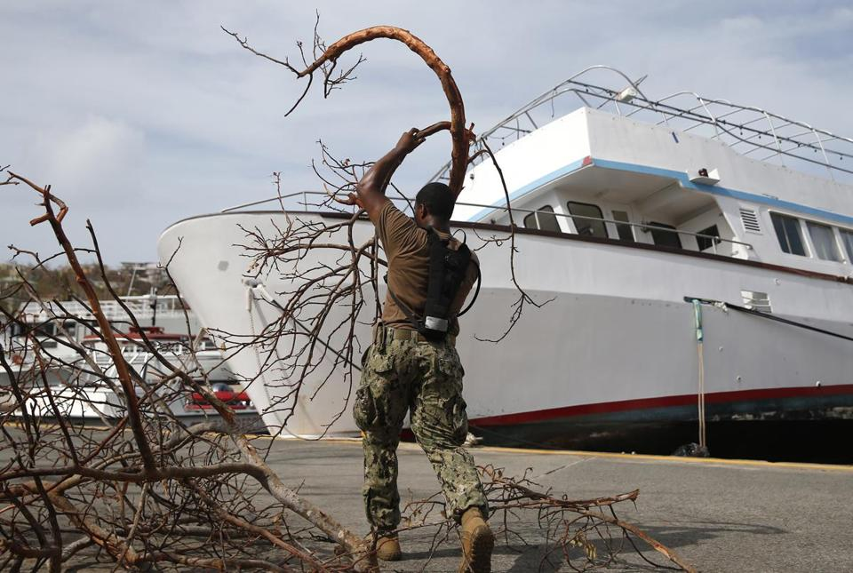 A member of the Navy clears brush, moved by Hurrican Irma, from the Cruz Bay section of St. John.