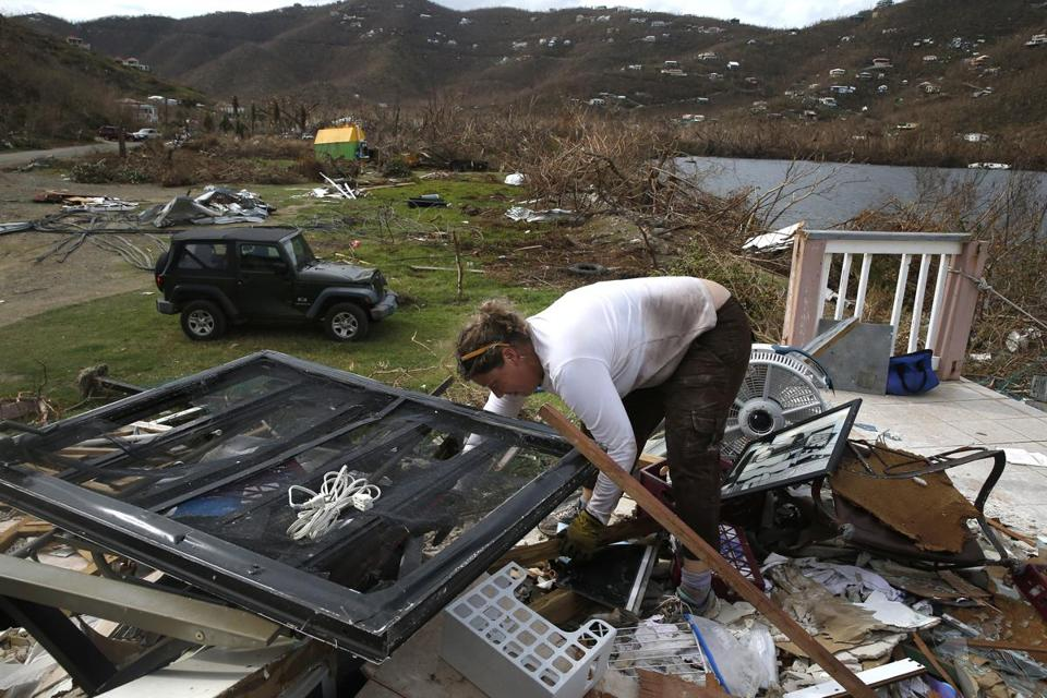 Heidi Arnold sorted through the wreckage of her office in Coral Bay to see if she could salvage anything in the Coral Bay section of St. John.