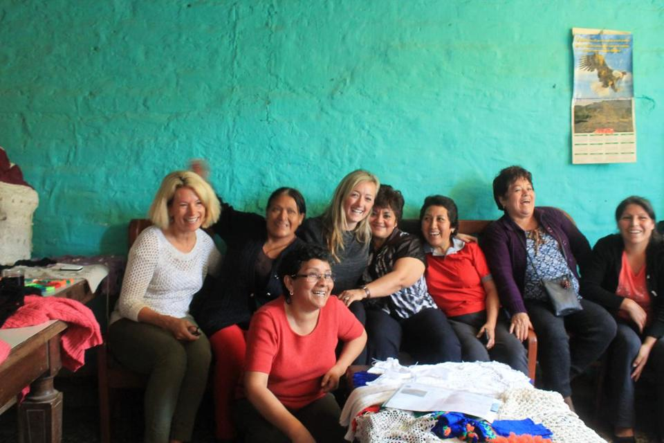 Christina Fagan (center) with the Peruvian women who knit beanies for her company.