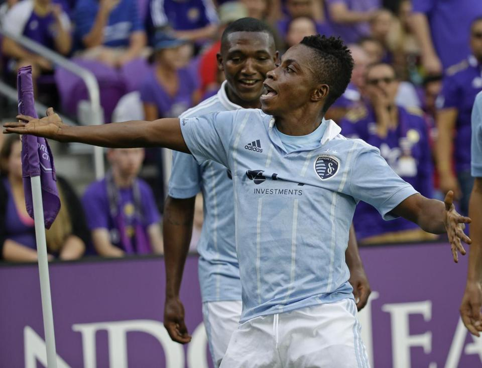 Sporting Kansas City's Latif Blessing celebrates after scoring a goal against Orlando City during the first half of an MLS soccer match, Saturday, May 13, 2017, in Orlando, Fla. (AP Photo/John Raoux)