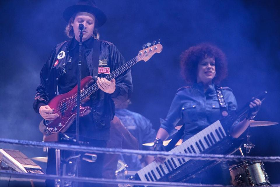 9/15/2017 - Boston, MA: Win Butler, left and Regine Chassagne perform with Arcade Fire at TD Garden in Boston on Sep. 15, 2017. (Ben Stas for The Boston Globe)