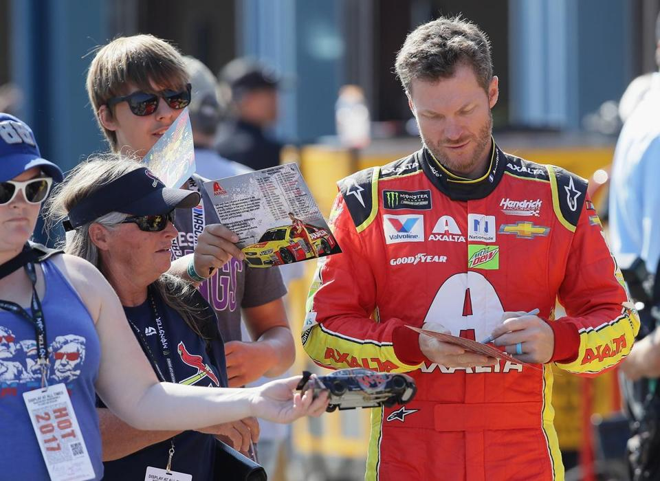 JOLIET, IL - SEPTEMBER 16: Dale Earnhardt Jr., driver of the #88 AXALTA Chevrolet, signs autographs for fans during practice for the Monster Energy NASCAR Cup Series Tales of the Turtles 400 at Chicagoland Speedway on September 16, 2017 in Joliet, Illinois. (Photo by Jonathan Daniel/Getty Images)