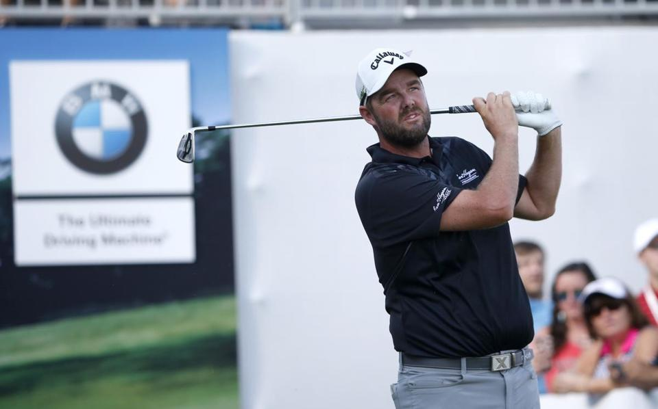 Marc Leishman watches his tee shot on the 17th hole during the third round of the BMW Championship golf tournament at Conway Farms Golf Club, Saturday, Sept. 16, 2017, in Lake Forest, Ill. (AP Photo/Charles Rex Arbogast)