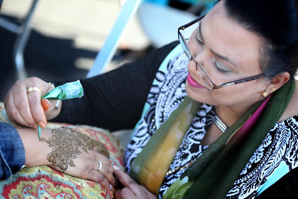 Noureen from Noureen Design in Framingham did a henna painting on a festival-goer's hand.