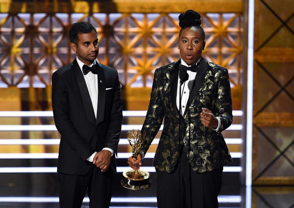 Aziz Ansari (left) and Lena Waithe accepted outstanding writing for a comedy series for 'Master of None' (episode 'Thanksgiving').