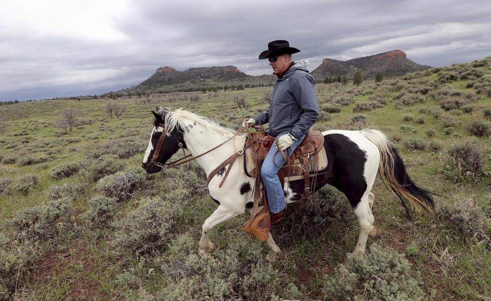 Interior Secretary Ryan Zinke rode a horse in the Bears Ears National Monument near Blanding, Utah, earlier this year. A leaked memo from Zinke to President Trump recommends that Bears Ears be reduced.