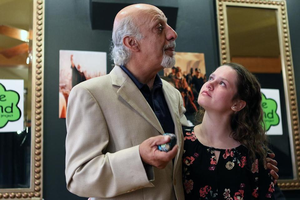 "Veteran Hollywood actor Erick Avari, honors Paige Fortin, for her courage and kindness, during his stop at the Noshery, during his cross country - travels, speaking about ""Be Kind."" Mark Lorenz for the Boston Globe"