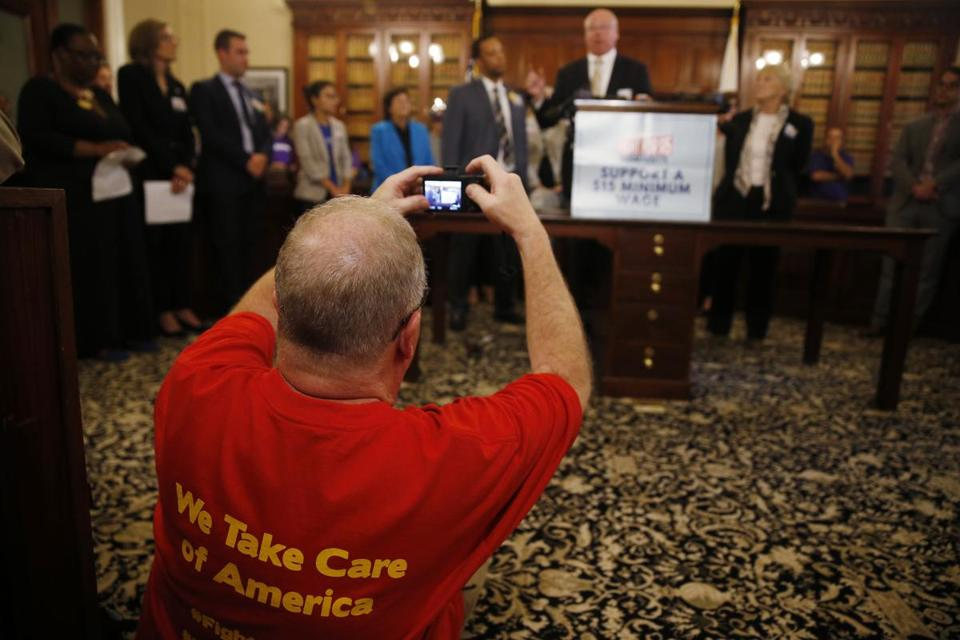 Boston, MA -- 9/19/2017 - A man takes a picture of Steve Tolman, President MA AFL-CIO as he speaks during a press conference held to support slowly increasing the state's minimum wage to $15/hour. (Jessica Rinaldi/Globe Staff) Topic: 20minimumwagepic Reporter: