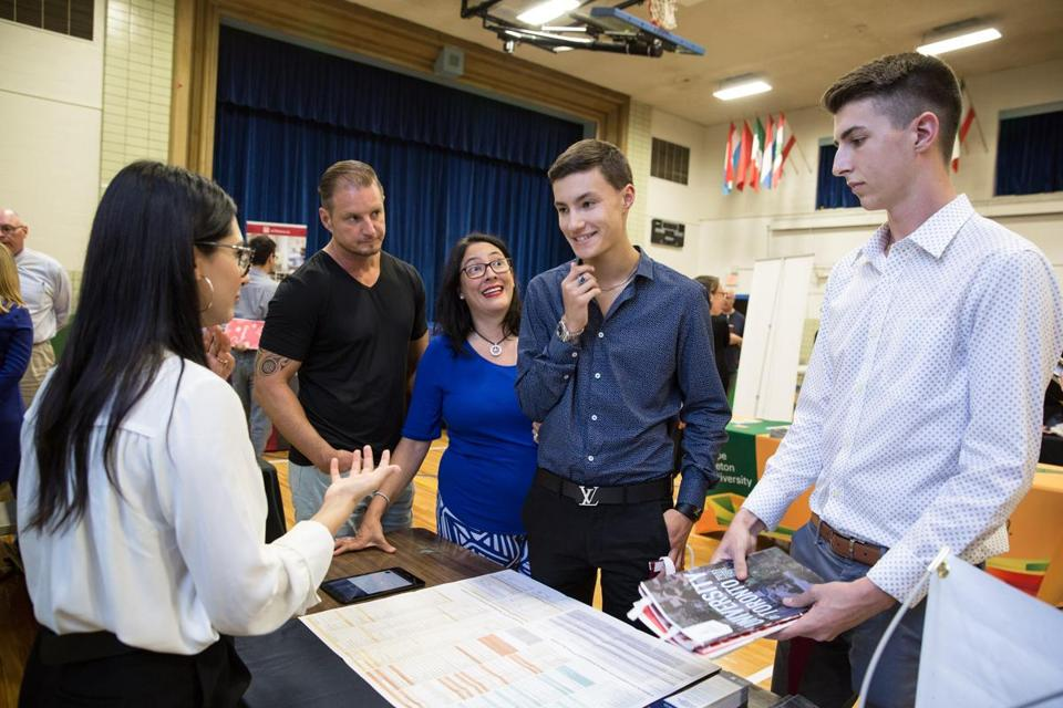 From left to right: Mariya Kala, recruiter from the University of Toronto, talked with Jon Bowers, Lina Bowers, Jonathan Bowers, 17, and Zeth Oakes, 17, about what the school has to offer during the EduCanada fair.