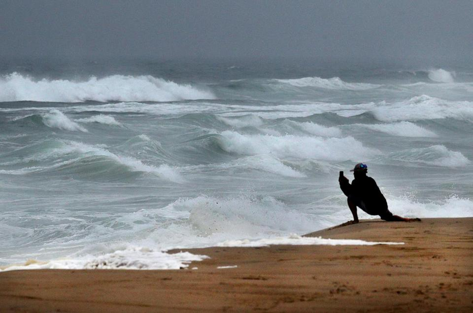 A man took a photo of the rough surf along Nauset Beach at high tide on Tuesday.