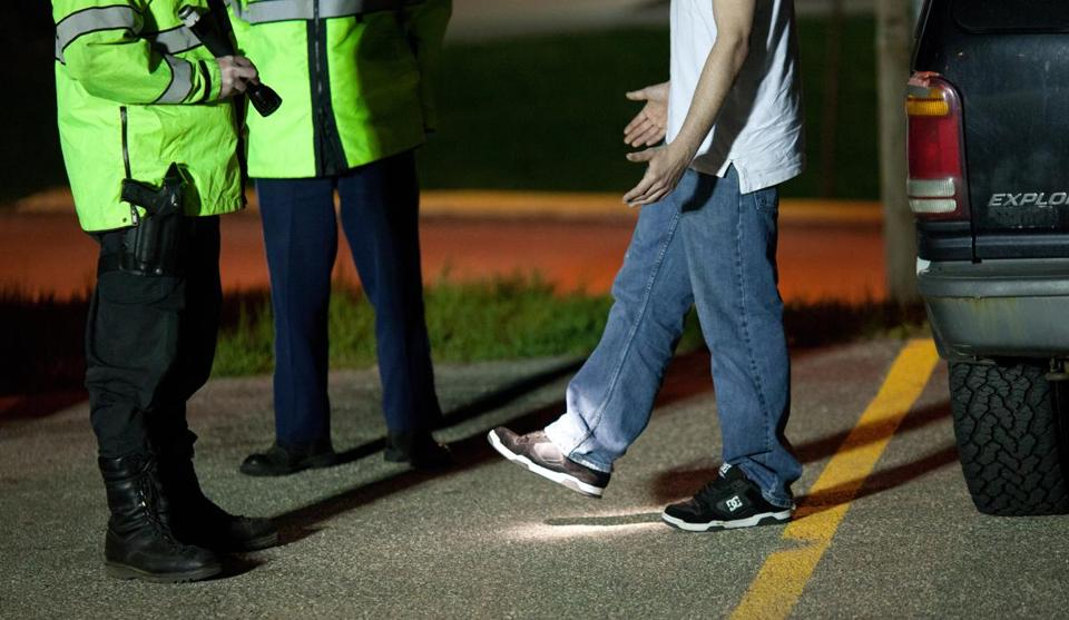 Members of the Mass. State Police performed a sobriety test on a driver in Chicopee in 2011.