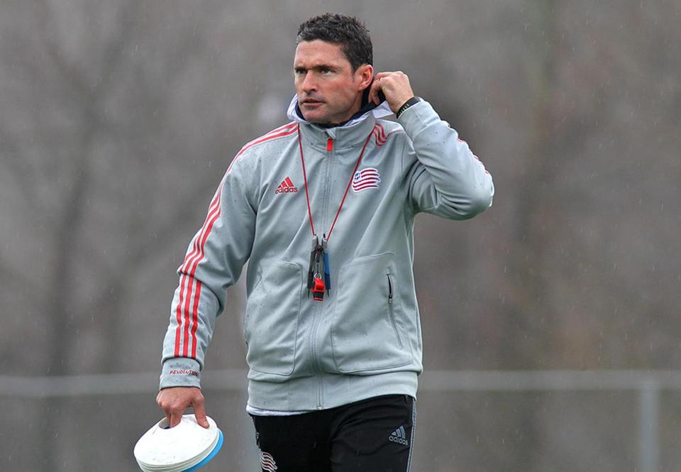 Foxboro, MA-12/3/2014--Head coach Jay Heaps (cq) overseas warm-up drills. The New England Revolution practice at Gillette Stadium, on Wednesday, December 3, 2014. They are preparing for the MLS Cup Final at the LA Galaxy. Photo by Pat Greenhouse/Globe Staff Topic: Revolution Reporter: John Powers