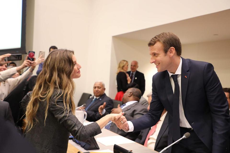 French President Emmanuel Macron greets Brazilian supermodel Gisele Bundchen at the United Nations Tuesday.