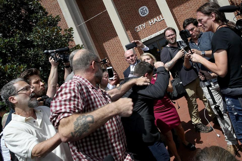"CHARLOTTESVILLE, VA - AUGUST 13: A counter protester tries to punch Jason Kessler, an organizer of ""Unite the Right"" rally, after Kessler tried to speak outside the Charlottesville City Hall on August 13, 2017 in Charlottesville, Virginia. The city of Charlottesville remains on edge following violence at a 'Unite the Right' rally held by white nationalists, neo-Nazis and members of the 'alt-right' (Photo by Win McNamee/Getty Images)"