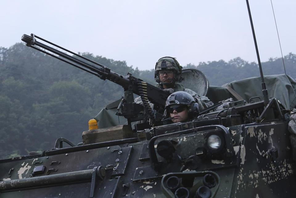 US Army soldiers ride an armored vehicle during a joint military exercise between the United States and South Korea at the Rodriquez Multi-Purpose Range Complex in Pocheon, South Korea, on Sept. 19.