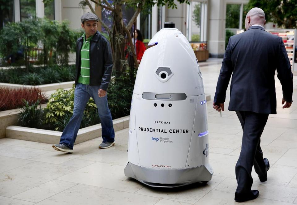 People check out the Knightscope K5 security robot as it roams the Prudential Center.