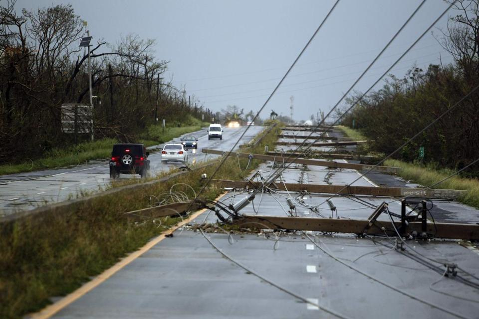 Concrete power line poles laid on a highway in Luquillo, Puerto Rico on Wednesday.