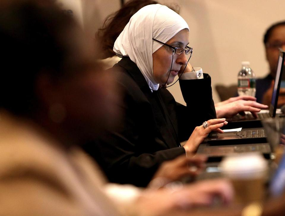 Boston, MA - 9/20/2017 - Hanaa Alshaleh, cq, of Malden, taking an online assessment test at the Tufts Medical Center skills-based Hiring Fair at Revere Hotel. - (Barry Chin/Globe Staff), Section: Magazine, Reporter: Katie Johnston, Topic: xxTufts Hiring Fair, LOID: 8.3.3721470815.