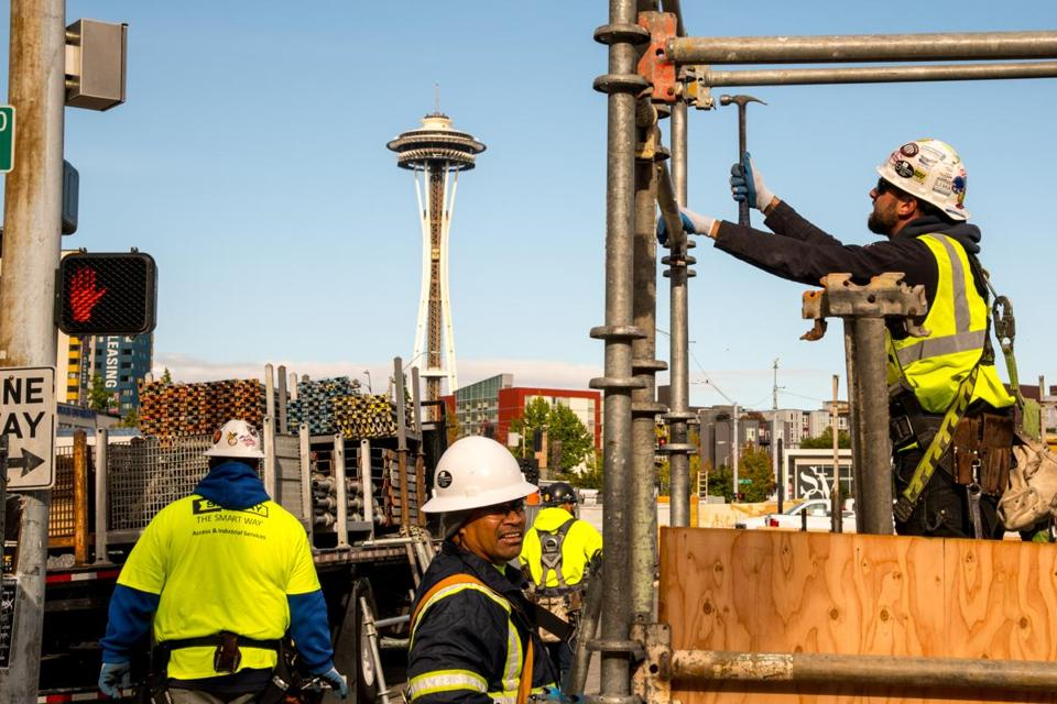 Construction workers toiled on another high-rise office tower for Amazon in Seattle earlier this month.