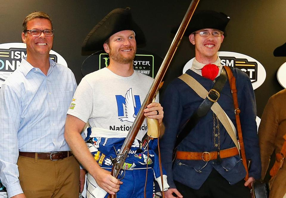 LOUDON, NH - SEPTEMBER 22: Dale Earnhardt Jr., driver of the #88 Nationwide Chevrolet, poses with colonial American reenactors following practice for the Monster Energy NASCAR Cup Series ISM Connect 300 at New Hampshire Motor Speedway on September 22, 2017 in Loudon, New Hampshire. (Photo by Jonathan Ferrey/Getty Images)