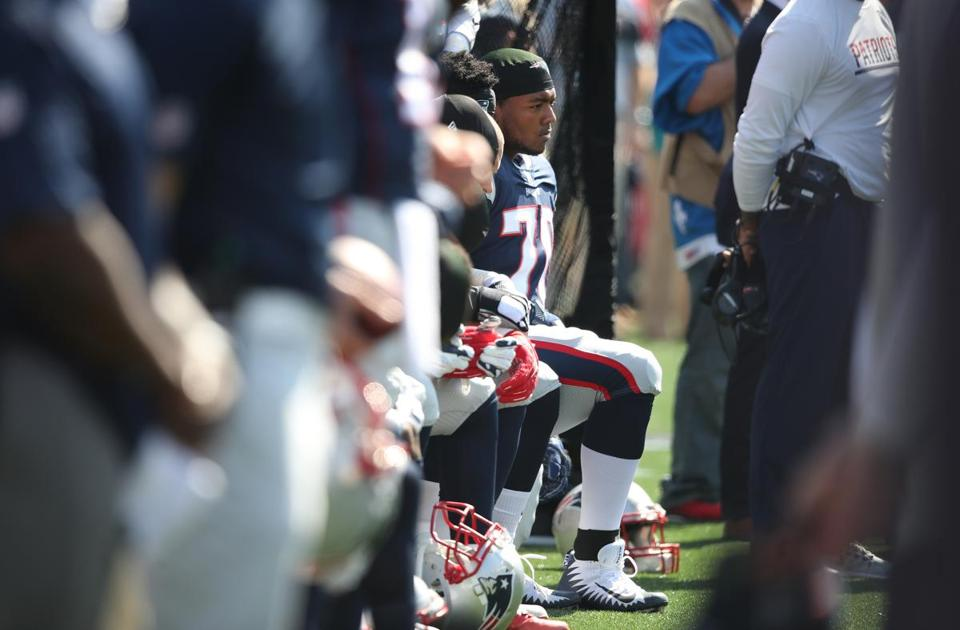 Adam Butler of the Patriots took a knee before Sunday's game.
