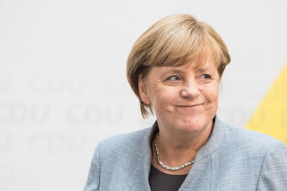 German Chancellor and Christian Democrat (CDU) Angela Merkel arrives to give a statement to the media the day after the CDU won 32.9 perecent of the vote and a first place finish in Sunday's German federal elections.