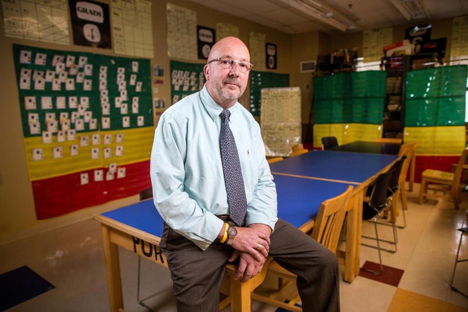 05/24/2016 MALDEN, MA Richard Bransfield (cq), Principal of the Linden S.T.E.A.M. Academy, poses for a photo next to literacy data at the school. (Aram Boghosian for The Boston Globe)