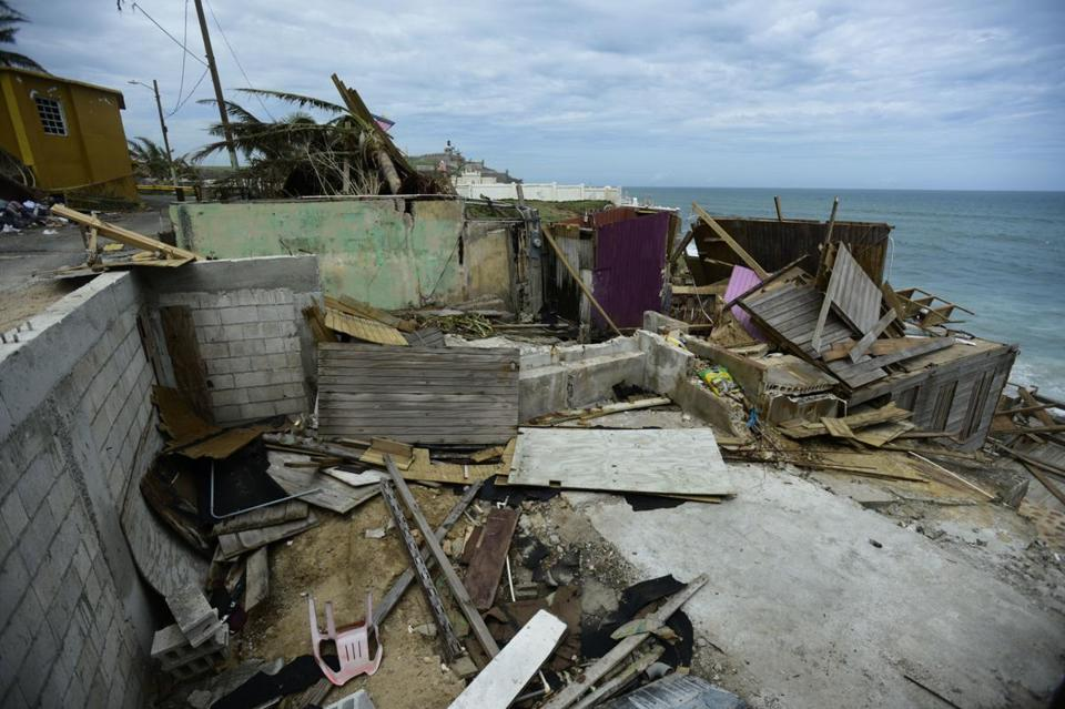 Debris lay scattered throughout the La Perla neighborhood of San Juan on Monday.