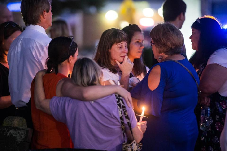 Laurie Tolliver, mother of Anthony Scaccia, was comforted during a vigil for her son held Tuesday on the Foxborough Town Common.