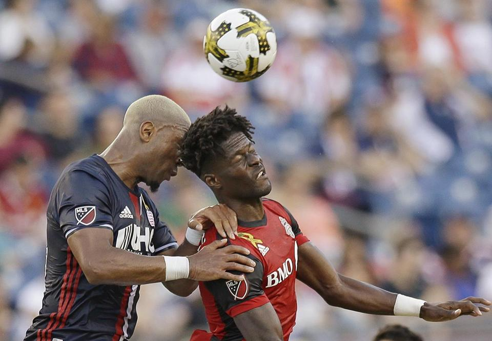 New England Revolution forward Juan Agudelo (17), left, and Toronto FC forward Tosaint Ricketts (87) bang heads as they compete for control of the ball during the first half of an MLS soccer match Saturday, Sept. 23, 2017, in Foxborough, Mass. (AP Photo/Stephan Savoia)