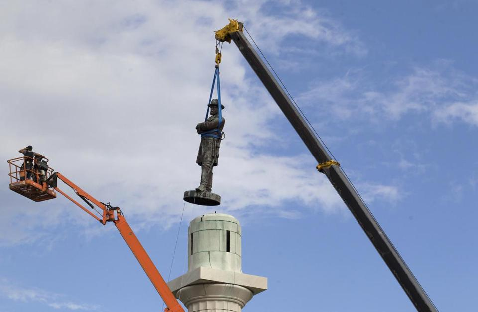 A statue of Confederate General Robert E. Lee is removed from Lee Circle in New Orleans earlier this year.