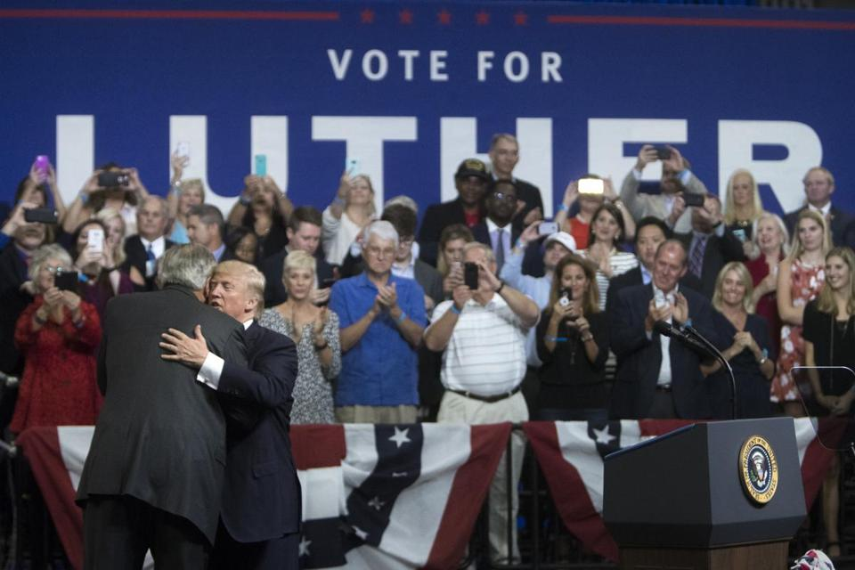 President Donald Trump embraced Senator Luther Strange during a campaign rally for Strange in Huntsville, Ala., last week.