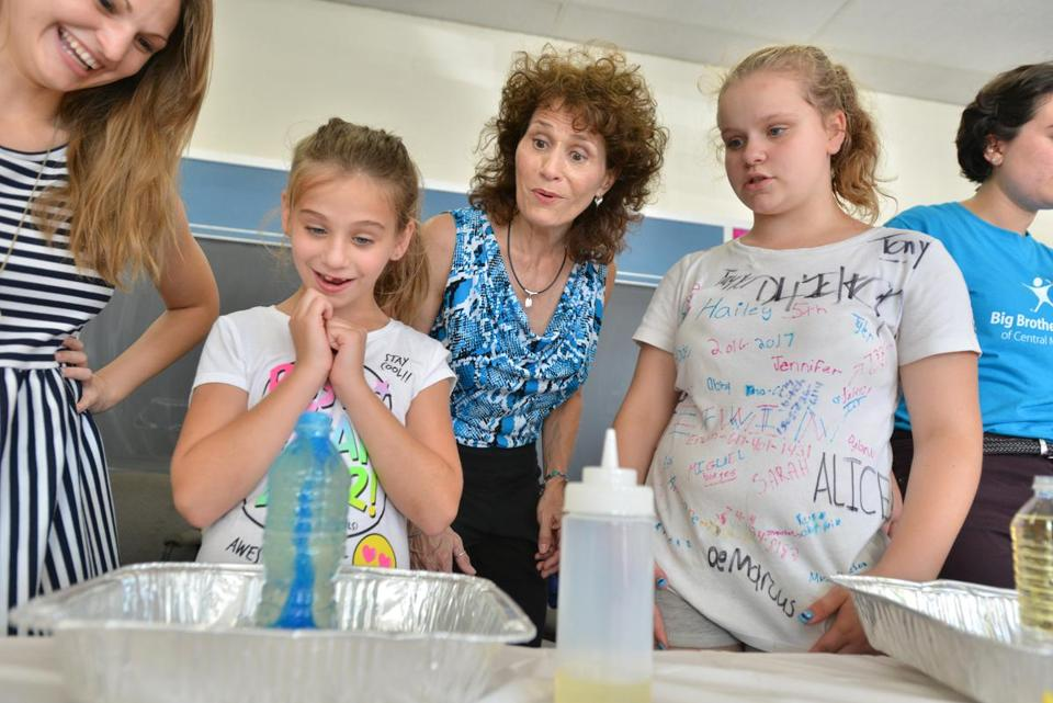 Tracey Gustafson (center), of Hudson, ran a chemistry reaction experiment with mentors and children from left)  Jacky Lyon, Taylor Cronis, Hailey Chiavarini, and Jessica Haggett of Big Brothers Big Sisters.