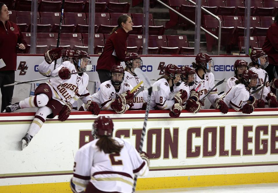 Chestnut Hill, MA - 10/21/2016 - BC women's hockey all-female coaching staff from L to R: Courtney Kennedy, Associate Head Coach Katie Crowley, Head Coach, Gillian Apps, Assistant Coach, on the bench during a recent home game. - (Barry Chin/Globe Staff), Section: Sports, Reporter: Shira Springer, Topic: Fair Play, LOID: 8.3.383674872.