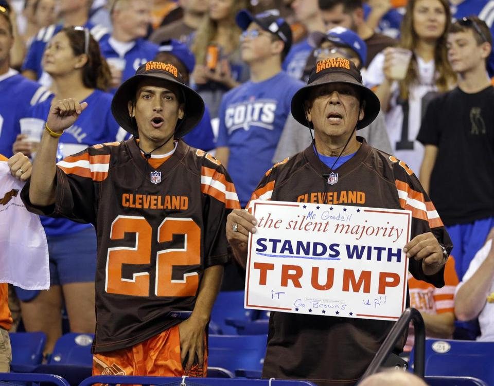 Cleveland Browns fans hold a sign after the national anthem at the Colts-Browns game on Sept. 24.