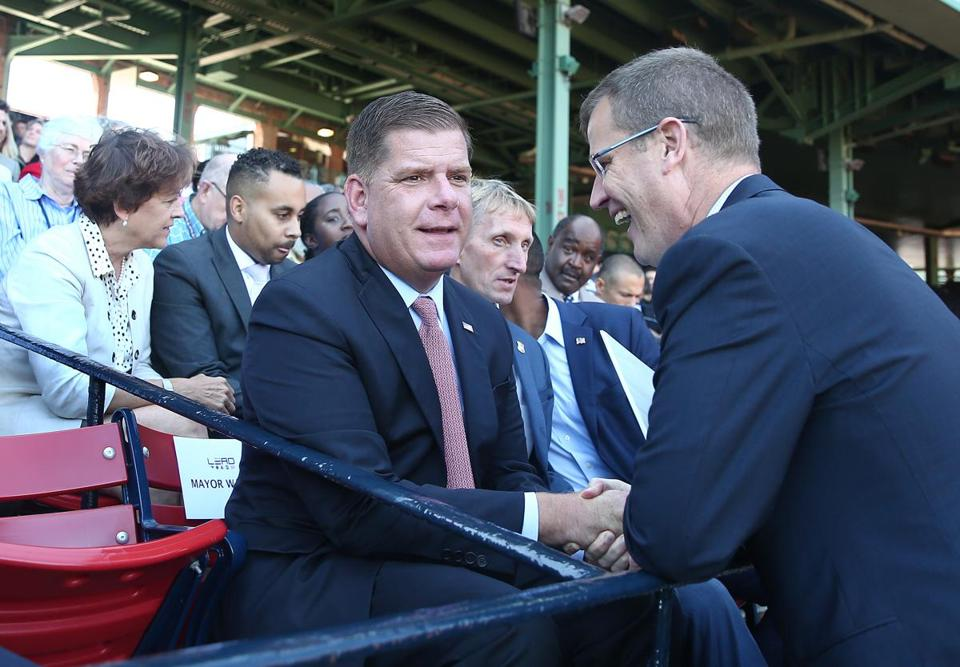 Mayor Martin J. Walsh is greeted by Red Sox CEO and president Sam Kennedy.