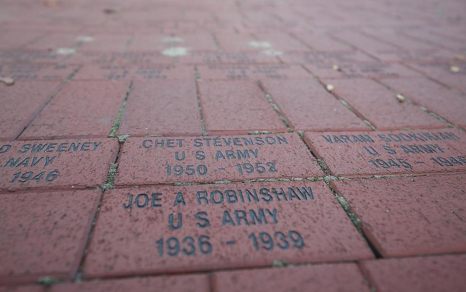 There are now more than 2,000 red bricks arranged in a tight circular formation on Waltham Common, chiseled with the names of veterans and their branches of service. Mangini would like his brick — his name — to be among them.