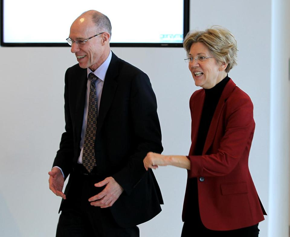 Framingham ,Massachusetts 02-01-2013 David Meeker,M.D. (cq) CEO-and President of Genzyme with U.S.Senator Elizabeth Warren (cq) right at the company's manufacturing facility in Framingham. The senator was on a tour at Genzyme in Framingham. ( Jonathan.Wiggs ) Topic: Reporter: