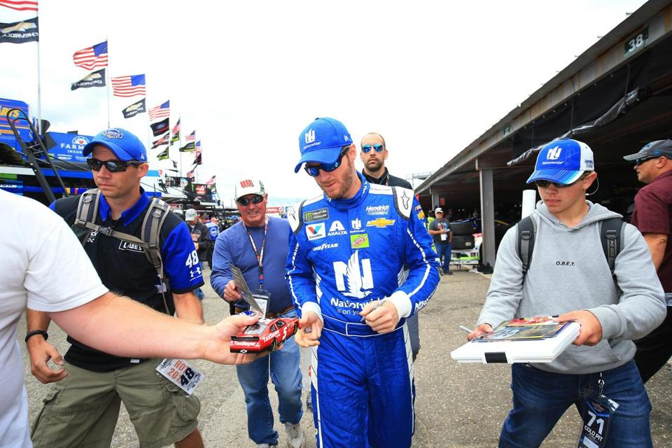 DOVER, DE - SEPTEMBER 30: Dale Earnhardt Jr., driver of the #88 Nationwide Chevrolet, signs autographs for fans during practice for the Monster Energy NASCAR Cup Series Apache Warrior 400 presented by Lucas Oil at Dover International Speedway on September 30, 2017 in Dover, Delaware. (Photo by Chris Trotman/Getty Images)